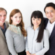portrait of young business group on white background